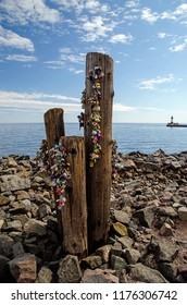 Love locks hanging on pilings on the shoreline of Lake Superior in Duluth, MN