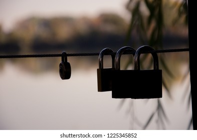 Love locks on a bridge in a park