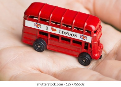 I love London message on red bus, souvenir and symbol of London City, isolated on woman's hand