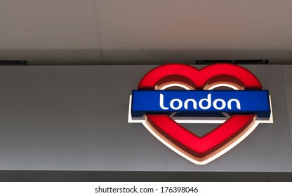 I Love London - Neon sign: London written on a blue  background in a red heart