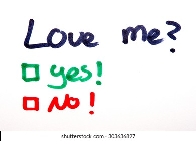 Love me, yes or no written on piece of paper