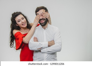 Love me with your eyes, closing your eyes. Romantic Valentine's Day. Love is a romantic date of the concept. Romantic surprise for a loved one. A man is dressed in a white shirt that covers the eyes