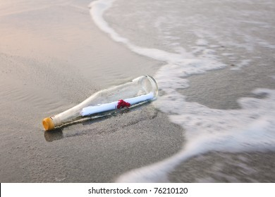 love message in glass bottle on the beach