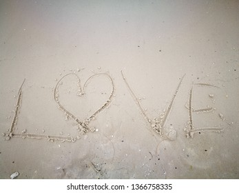 Love Message on white sand. sea and beautiful white sand beach, Summer vacation.