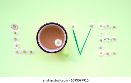 Love message written with flowers on green background. Individual Love concept.