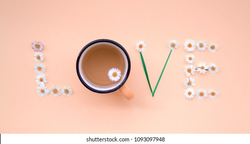 Love message written with flowers on pinkbackground. Individual Love concept.