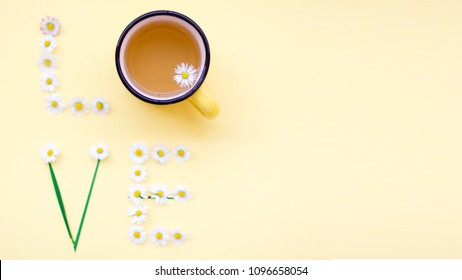 Love message written with flowers on yellow background. Space for input the text. Individual Love concept.