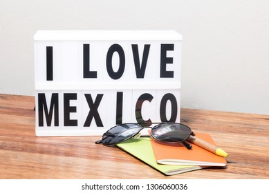 I love Mexico lightbox, sunglasses, notebook and pen, travel concept