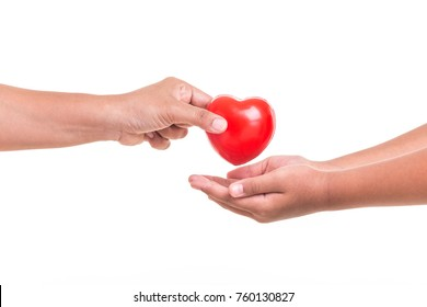Love Mom Concept : Mother holding and giving red heart to her daughter hand isolated on white background