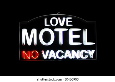 Love Motel no vacancy white and red neon sign