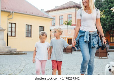 Love of mother and children. Happy woman and her  children walking around the city. Mothers day.