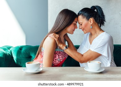 Love of mother and daughter, emotions with coffee.