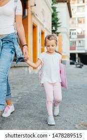 Love of mother and daughter. Mom and daughter with backpack walking to school. Mothers day. Back to school.
