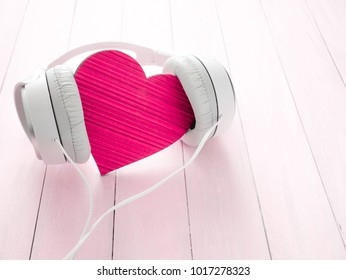 I love music. Headphones and heart concept for love listening to music. Valentine's Day