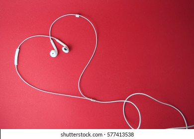 Love is in the music. Headphones with heart-shaped