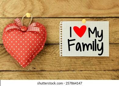 I love my family Card with heart. I love my family Card with heart on wooden background