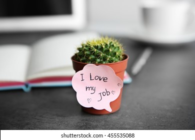 I love my job concept. Cactus in pot on grey table