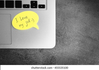 I love my job concept. Laptop with yellow sticker