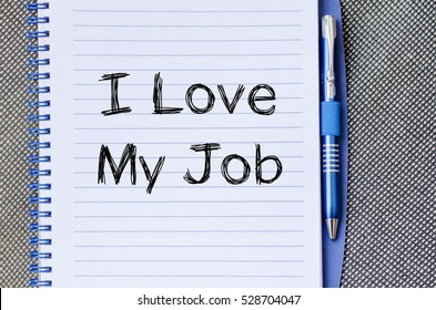 I love my job text concept write on notebook