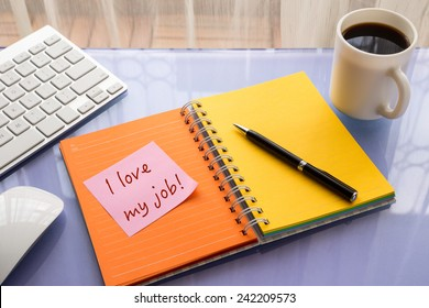 I love my job word on note pad stick on blank colorful paper notebook at home workspace
