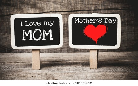 I love my mom and mother day phrase handwritten on the school blackboards on wood background