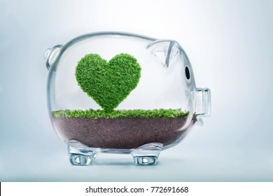 Love nature concept, with grass growing in the shape of a heart, inside a transparent piggy bank, symbolising the need to invest in the protection of the environment and to reconnect with nature.