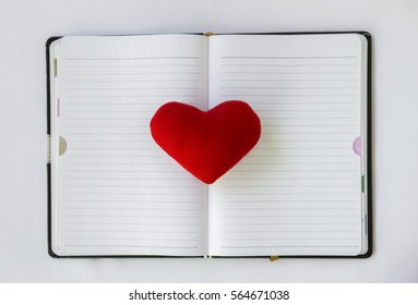 Love note, red heart on blank notebook, valentine concept