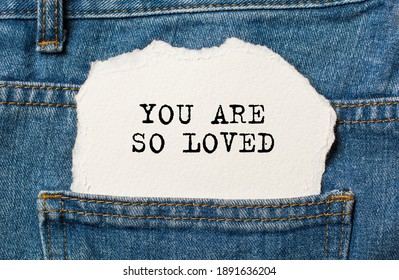 love on torn paper background on jeans love and valentine concept