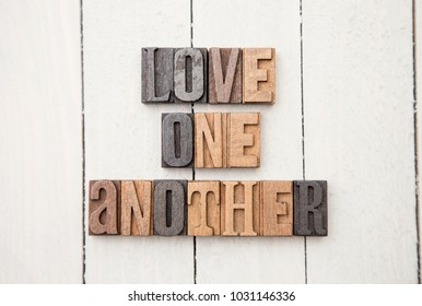 """""""Love One Another"""" Spelled in Type Set"""