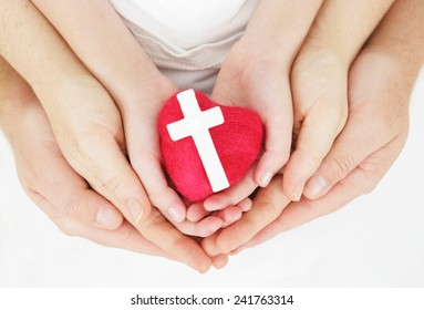 I love our faith - family hands holding heart and cross
