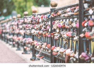Love padlocks attached to the bridge. Europe. Wedding and marriage tradition.