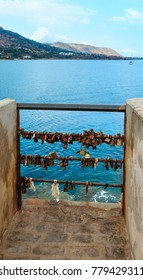 Love padlocks or love locks on a harbor of Cefalu old beautiful town, Palermo region, Sicily, Italy.