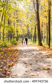 love, parenthood, family, season and people concept - smiling couple with baby in autumn park