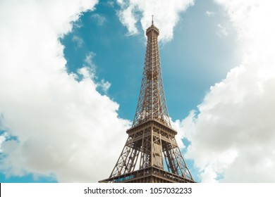 Love in Paris. Eiffel tower and heart shape in clouds - Valentine s Day concept, or romantic trip of couples in love. Eiffel Tower is one of the most iconic landmarks of France, and Paris is city of