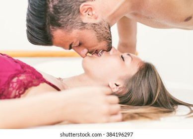 Love passion. Young happy couple kissing with inverted position. Beautiful couple intimacy moments