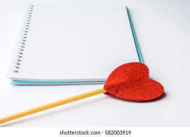 A Love pen blank note book over the white background.