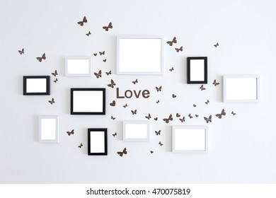 Love picture frames on white wall background