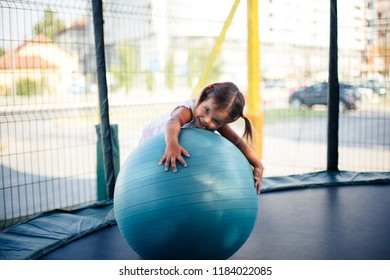 I love playing with ball. Little girl playing and using Pilates ball.