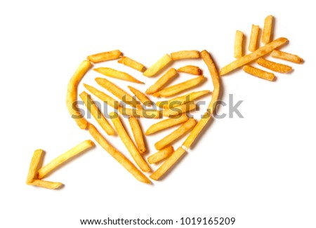 I love potatoes. French fries in the form of heart isolated on white background