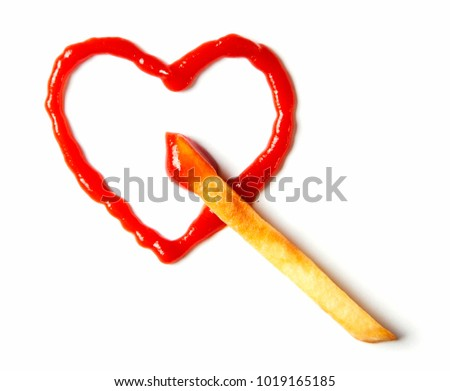 I love potatoes with ketchup. French fries and heart drawn ketchup isolated on white background