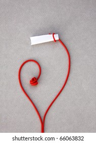 love red note paper: A stalk rolled up around an opened paper forming a heart and showing its contents: ready for your message