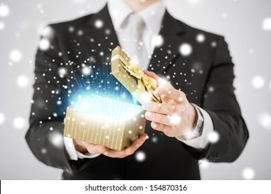 love, romance, holiday, celebration concept - man opening gift box