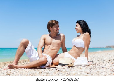 Love romantic couple beach summer, woman and man look each other face to face, ocean vacation holiday travel