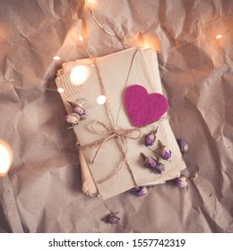 Love romantic letters laced with ribbon and flowers closeup. Valentines Day.