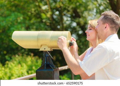 Love, romantic walks concept. Man and blonde woman looking through city telescope, sightseeing together