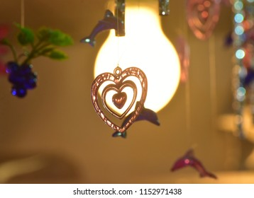 Love shape hanging  interior showpiece objects isolated unique blurry photo