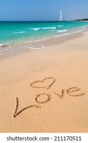 Love sign on the beach with turquoise water