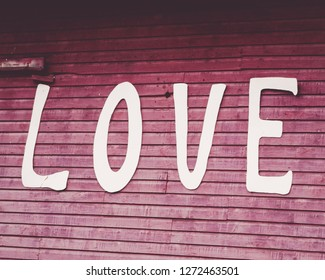 Love sign on a red barn.