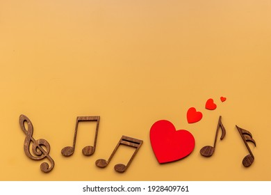 Love songs - musical wooden notes with heart, top view