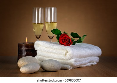 Love spa / Romantic spa decoration with candle, spa stones, rose and champagne